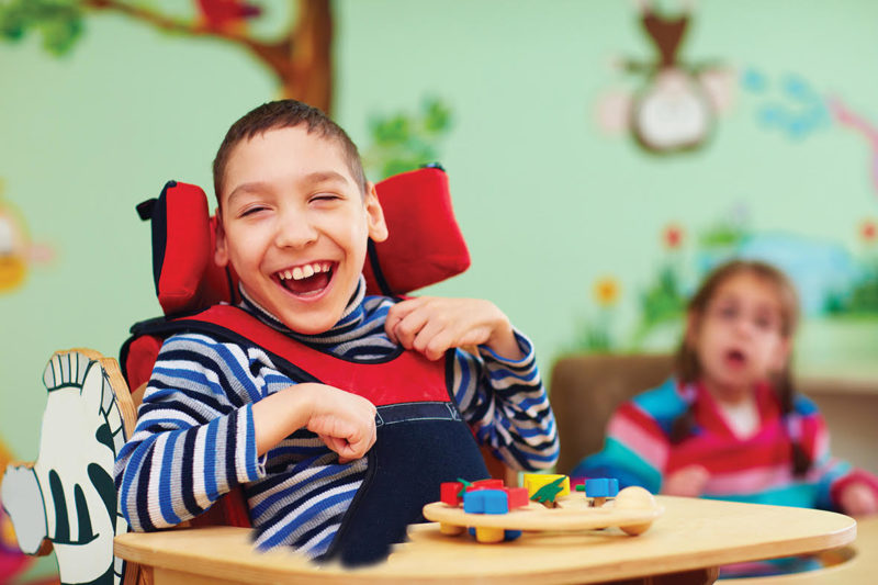 Child wiht disabilities smiling