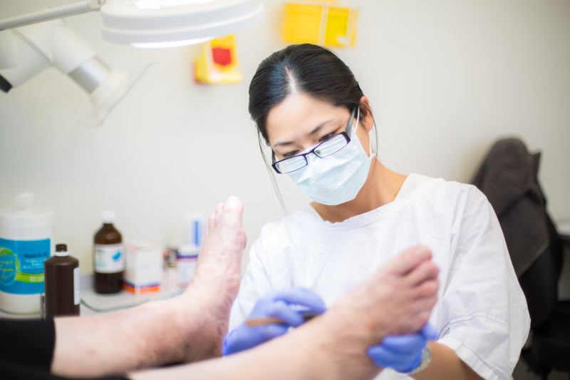 Podiatrist scraping foot