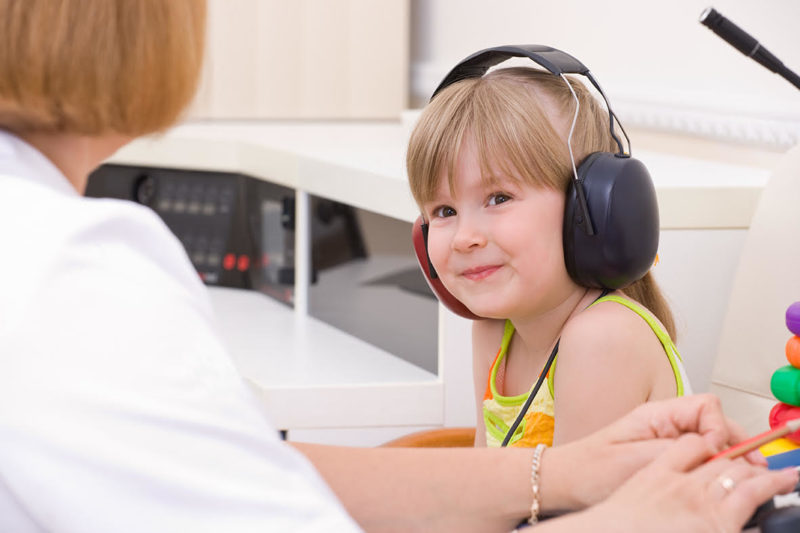 Child listening with headphones
